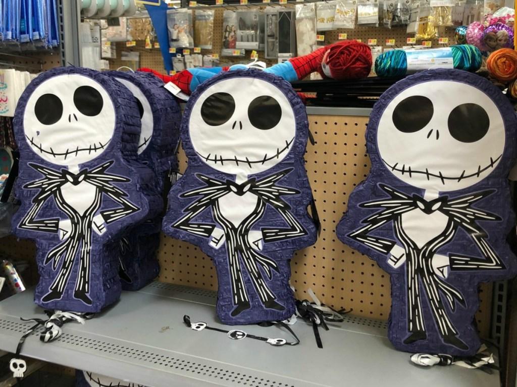 skeleton pinatas on store shelf