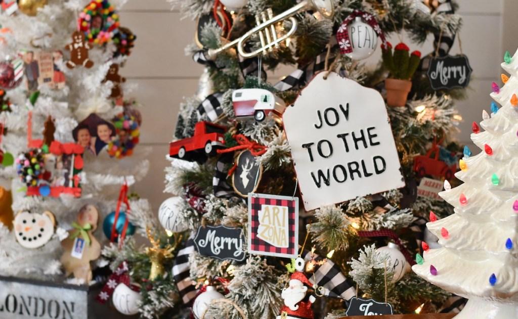 joy to the world sign on christmas tree