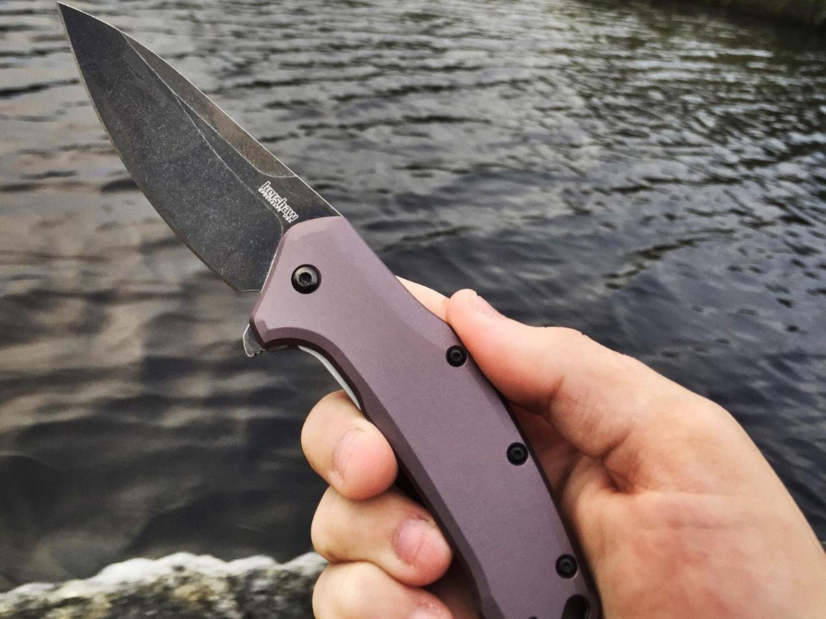 fisherman using a kershaw link knife on the river