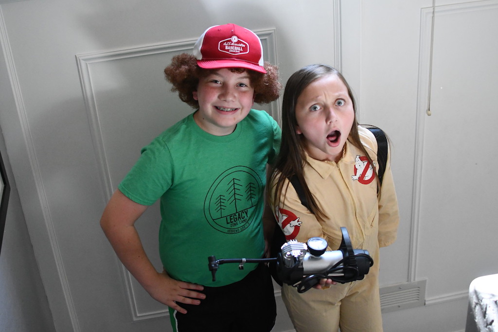 kids wearing Stranger Things Dustin and Ghostbuster Costumes
