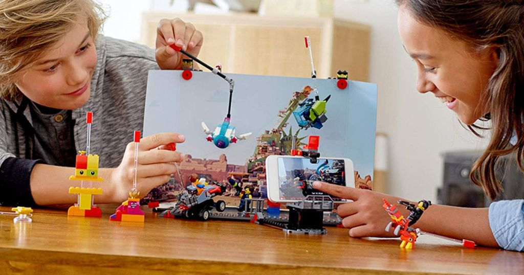 kids playing with lego movie set