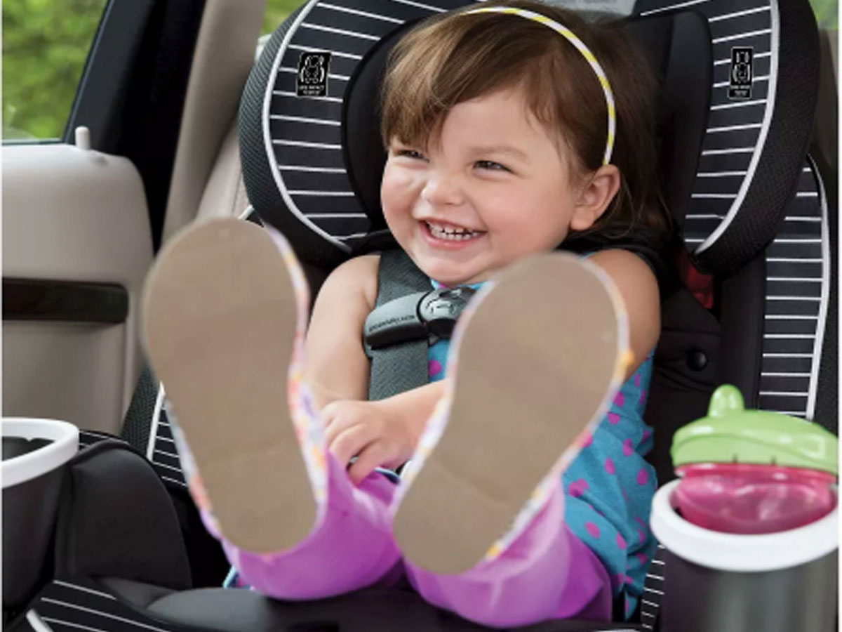 little girl laughing in graco 4ever 4 in 1 car seat
