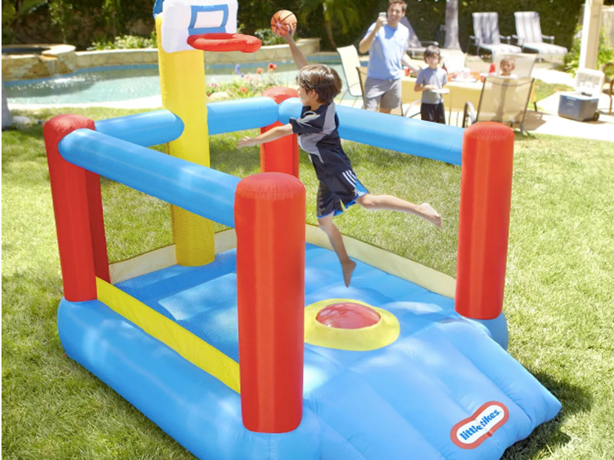 little tike slam n dunk bounce house outside with kids playing