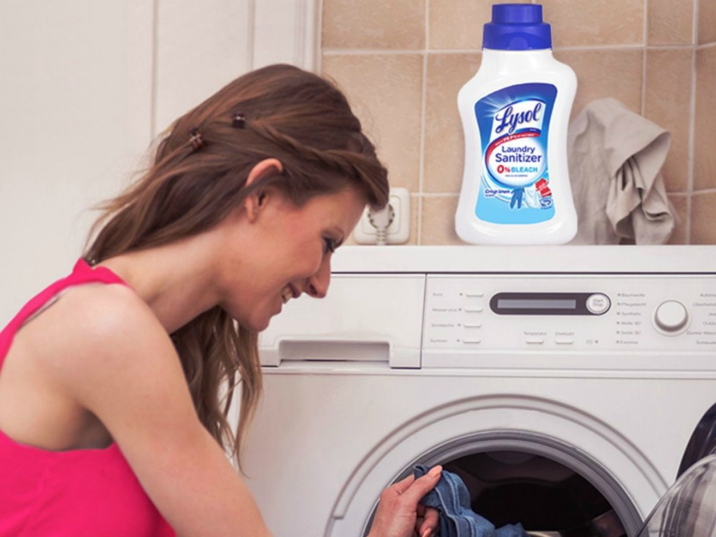 woman doing laundry by washer
