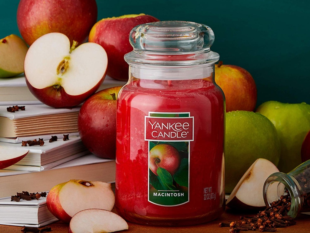 yankee candle macintosh with apples and books behind candle
