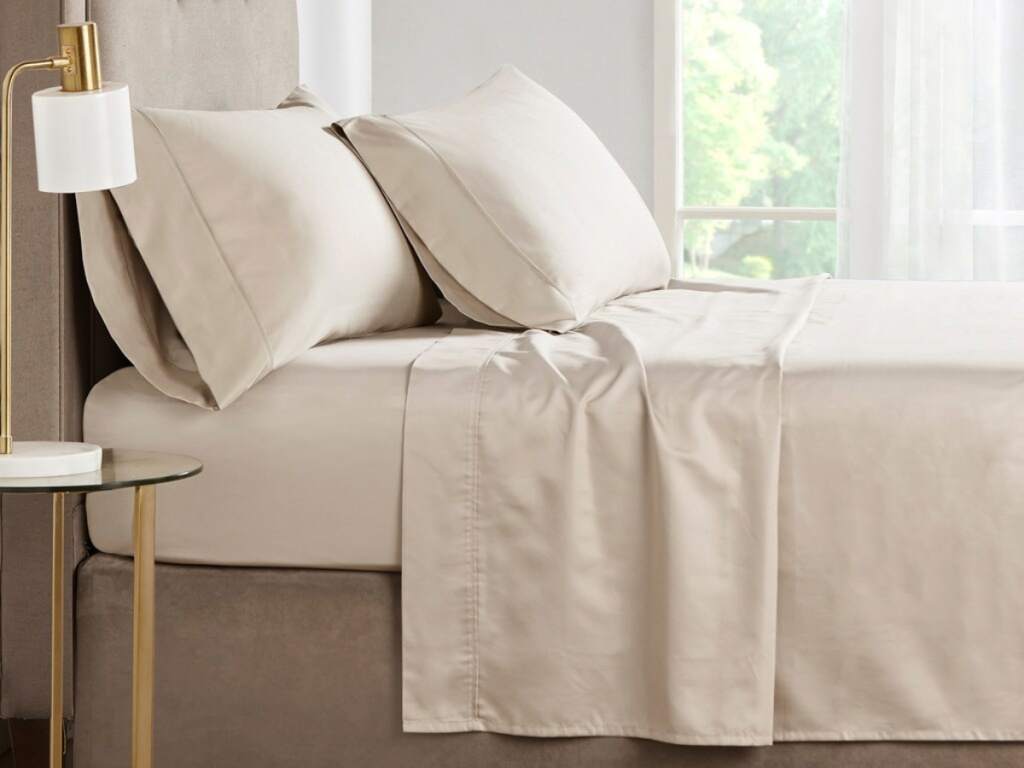tan sheet set on bed