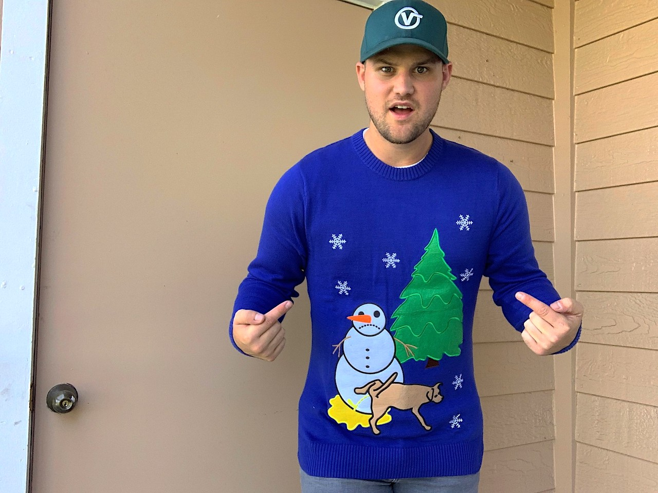 man wearing blue ugly christmas sweater