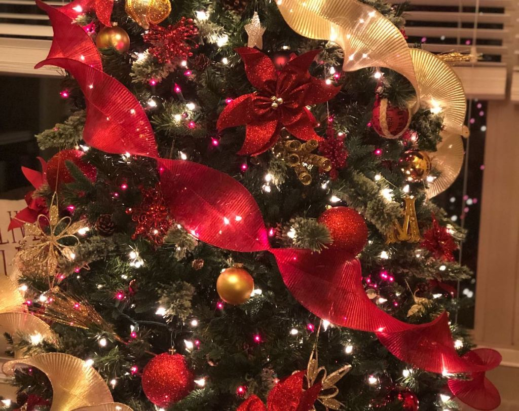 red and gold christmas tree with ornaments