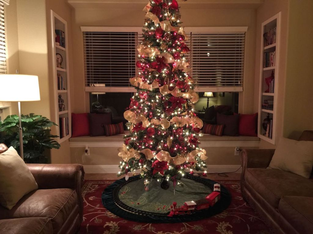 christmas tree in living room with train