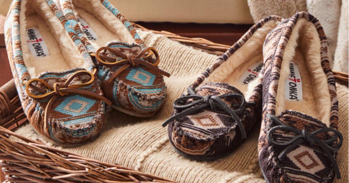2 pairs of Minnetonka Slippers on blanket in basket