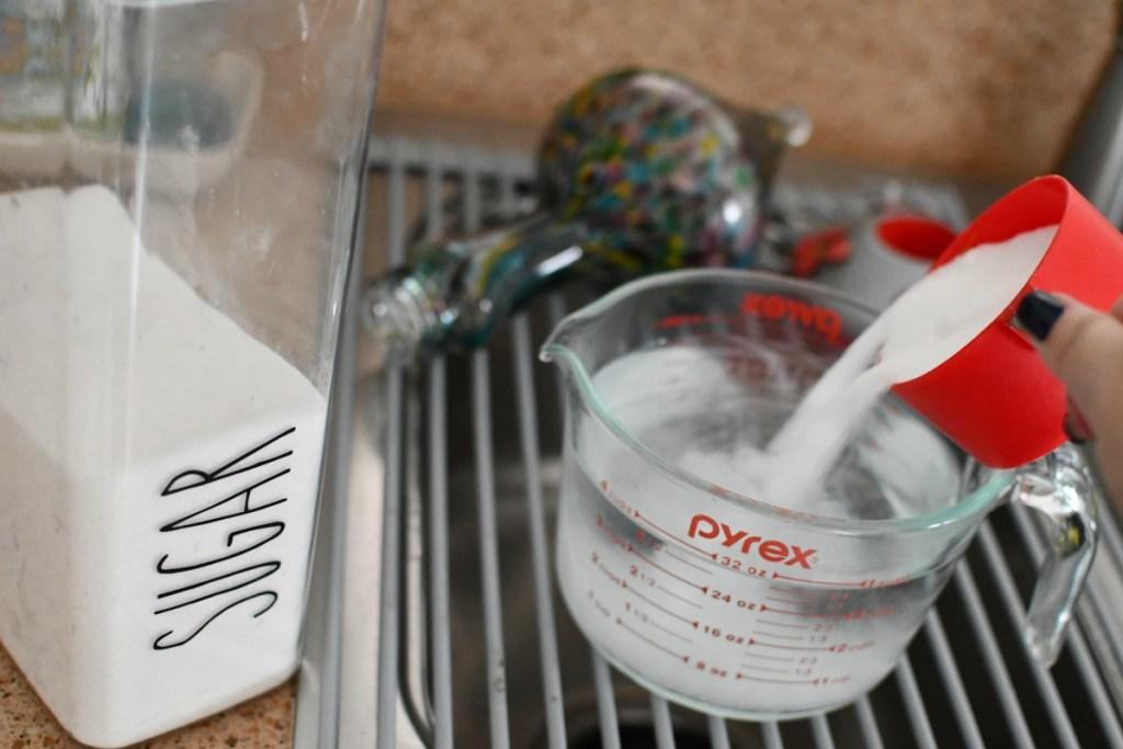 mixing sugar water hummingbird food