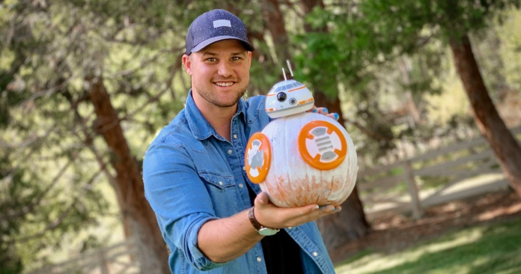 man holding BB-8 decorated pumpkin