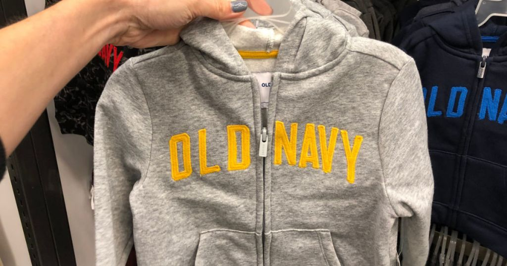 woman's hand holding old navy grey boys zip up hoodie