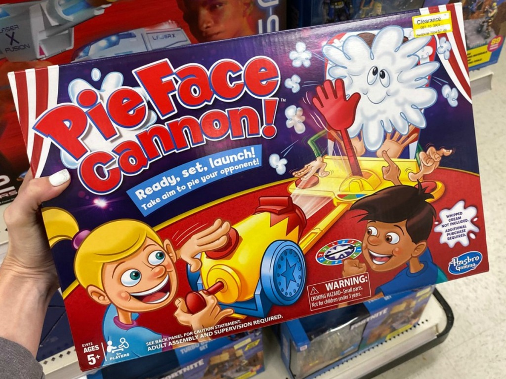hand holding game in store by shelves