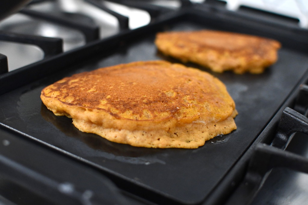 pumpkin pancakes on griddle