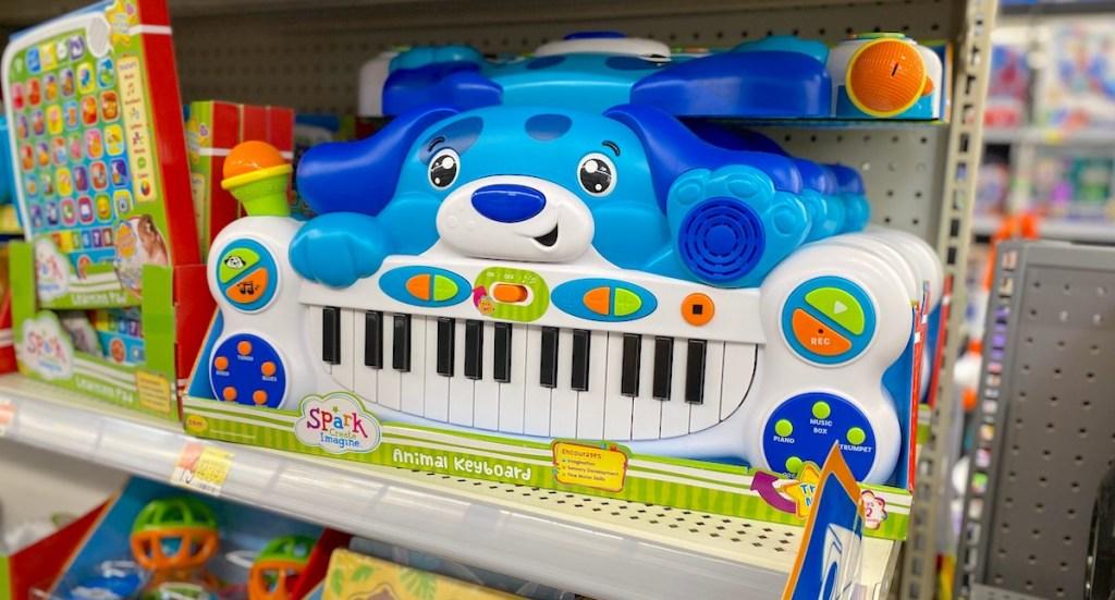 blue puppy piano sitting on store shelf