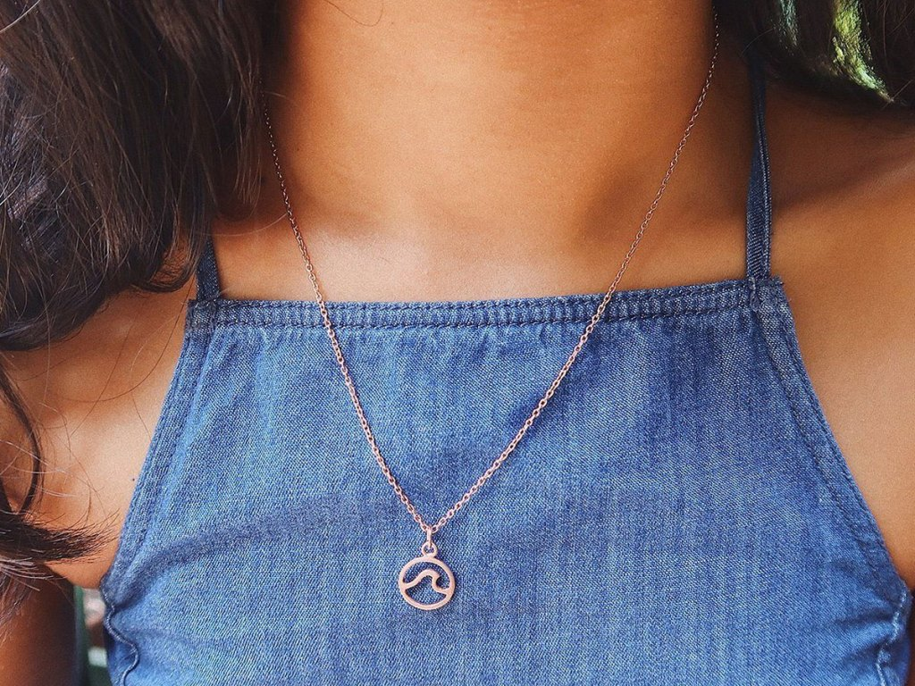 young girl wearing puravida wave necklace