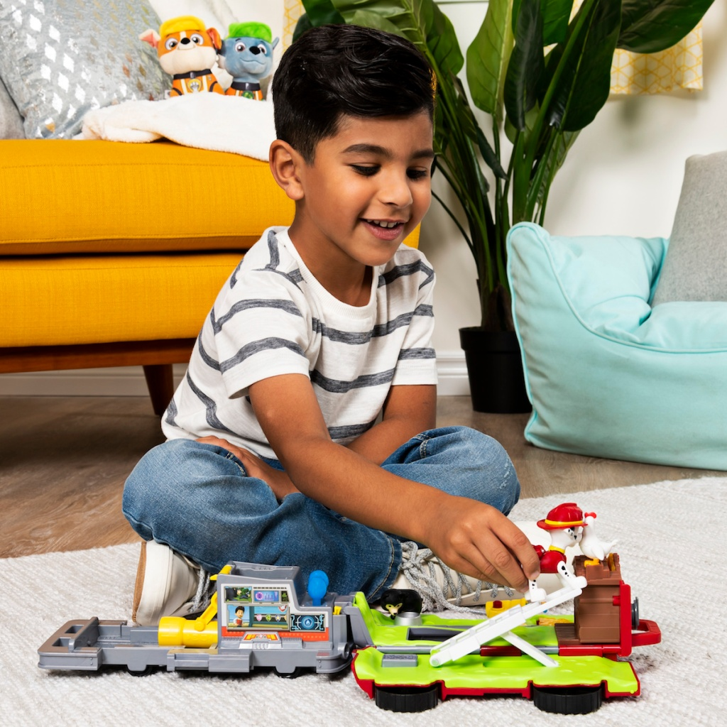boy playing with Paw Patrol Rescue Vehicle