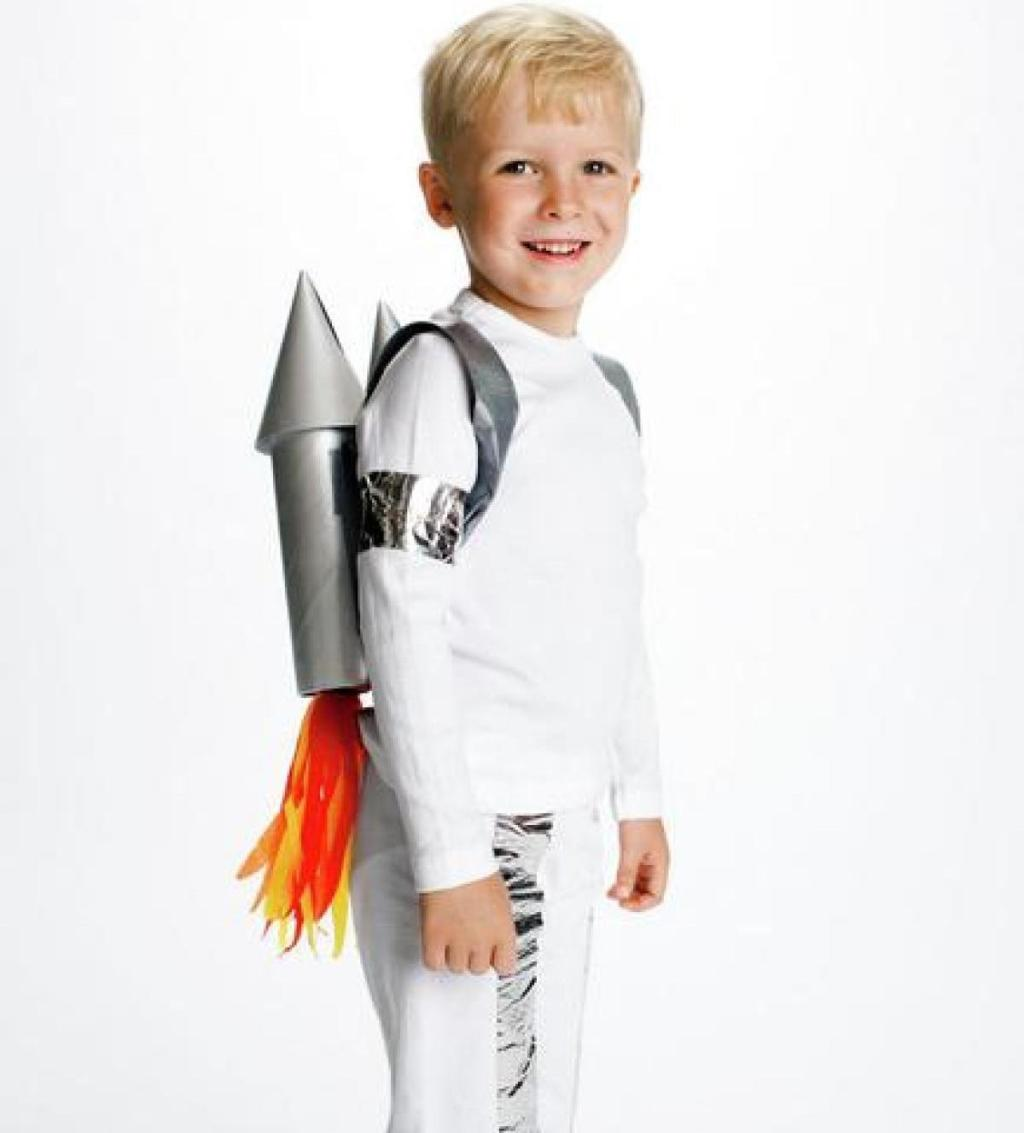 boy wearing white rocket ship man costume