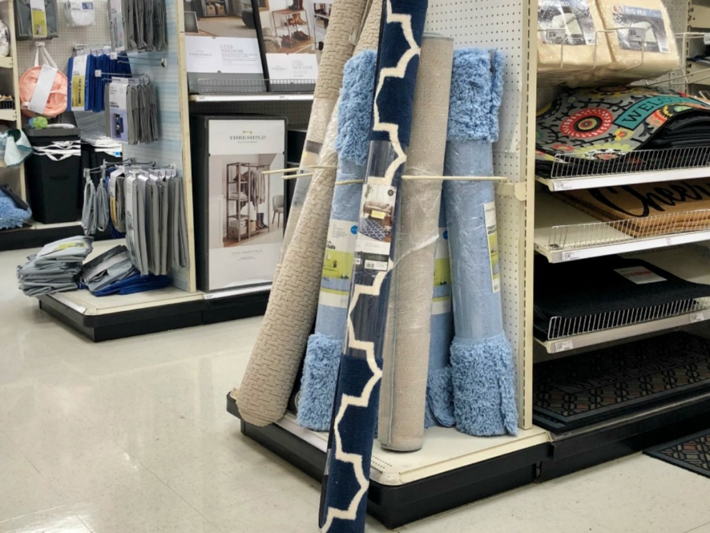 store display of carpets rolled up