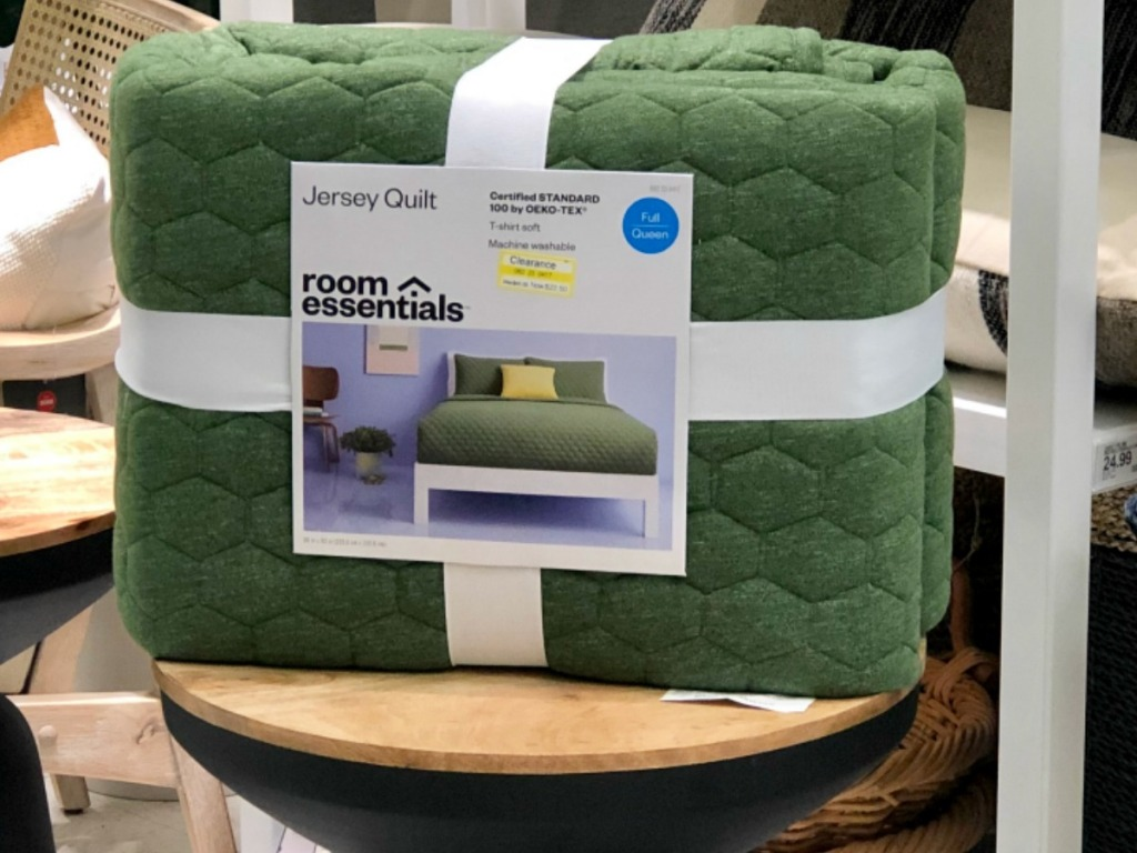 green quilt on table in store