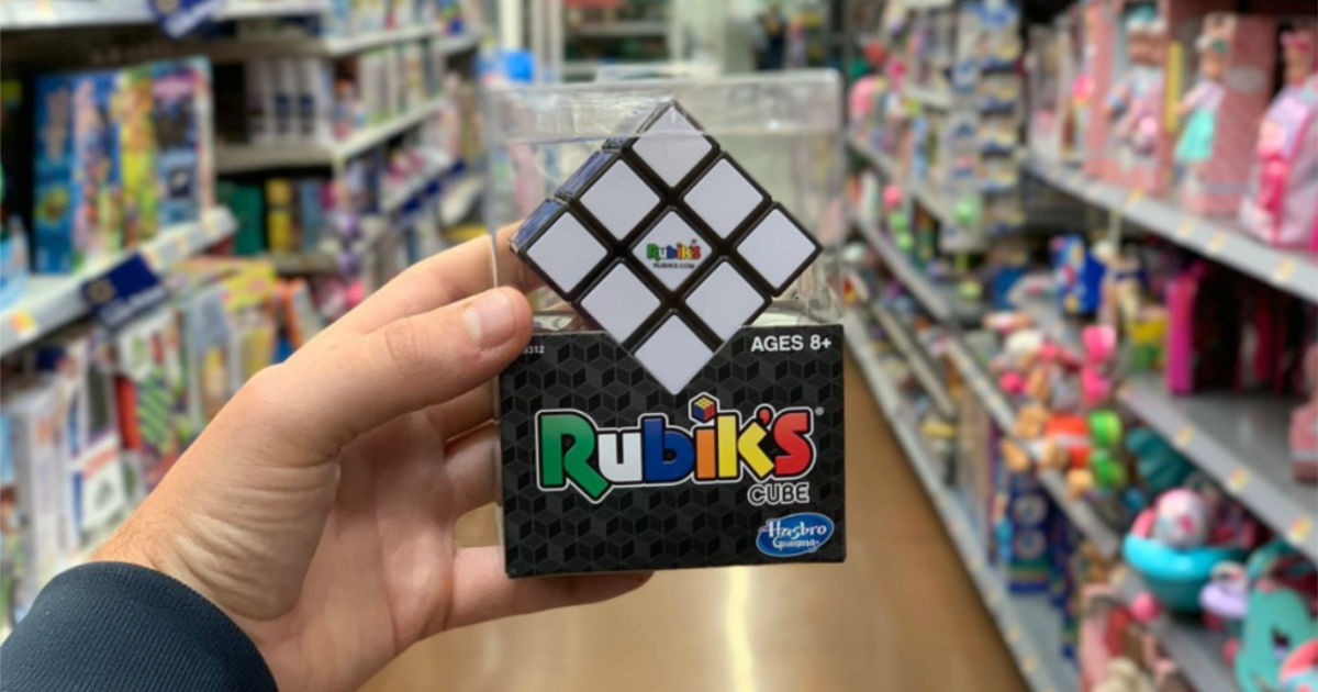 hand holding rubik's cube in store