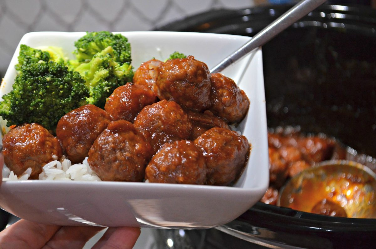 bowl with slow cooker cranberry meatballs and broccoli