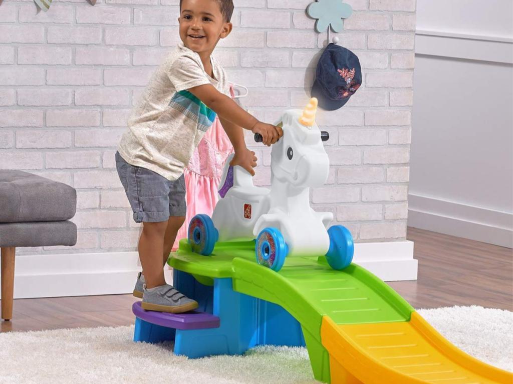 boy playing with Step2 Unicorn