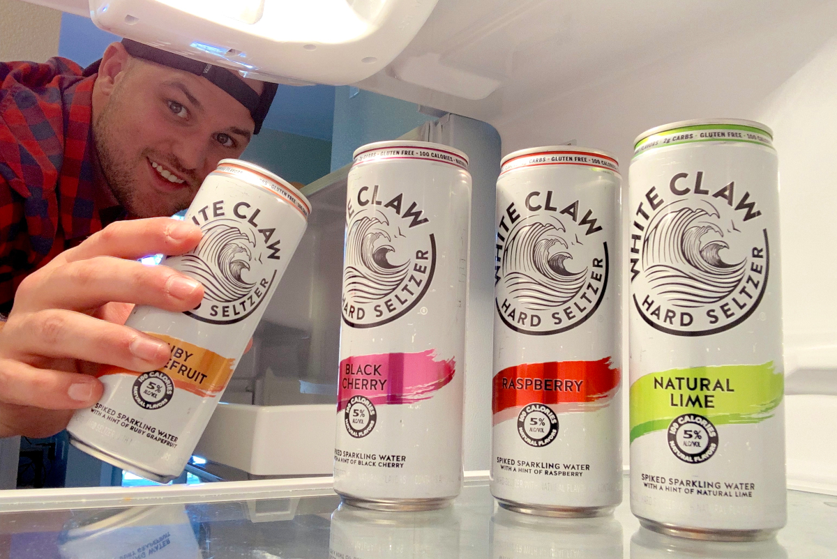 Stetson reaching in fridge for White Claw