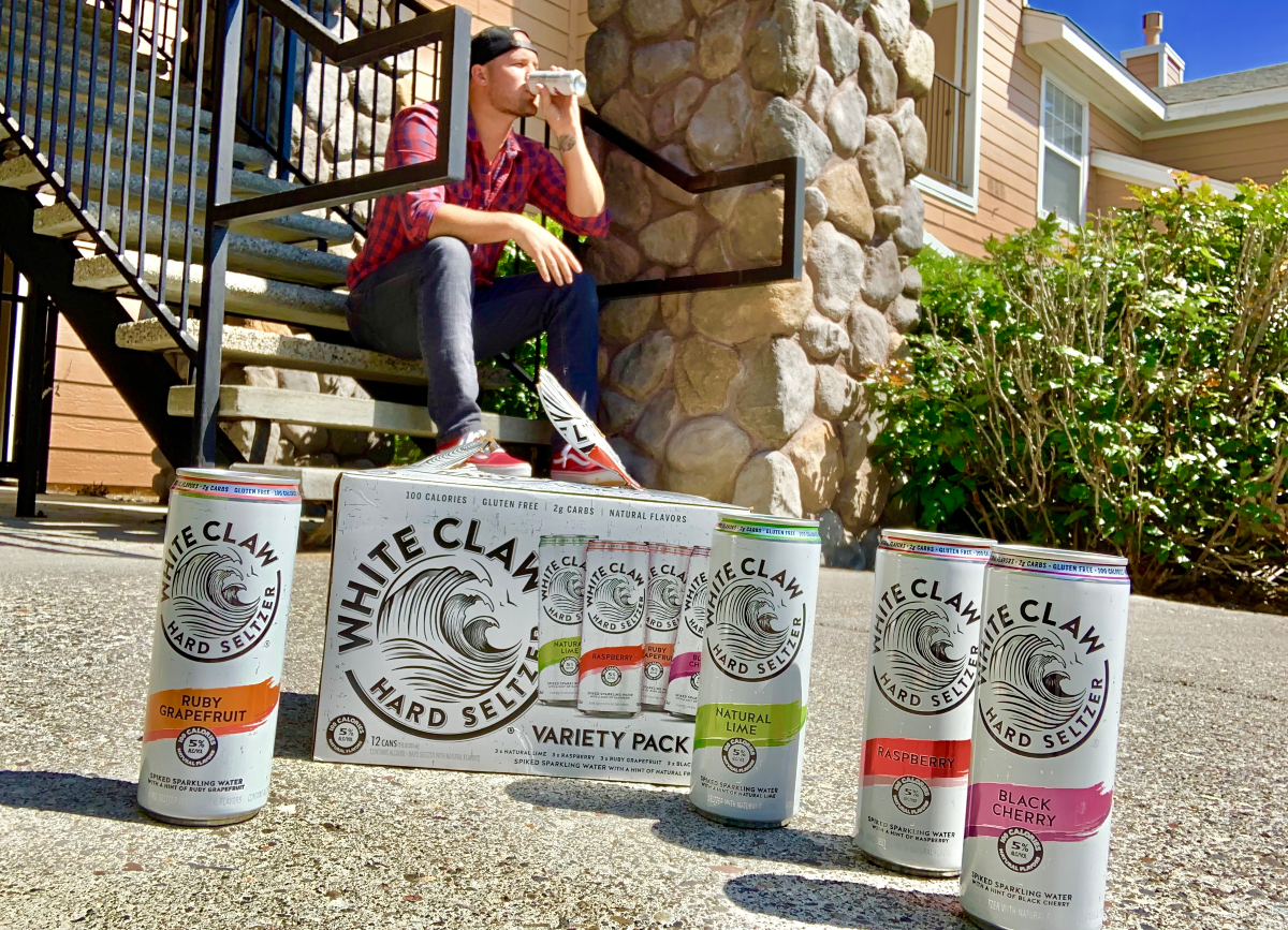 Stetson drinking white claw on steps