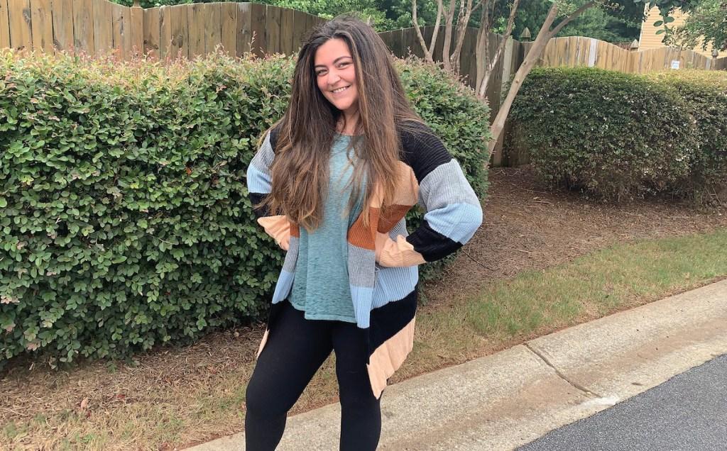 girl wearing stripe cardigan sweater