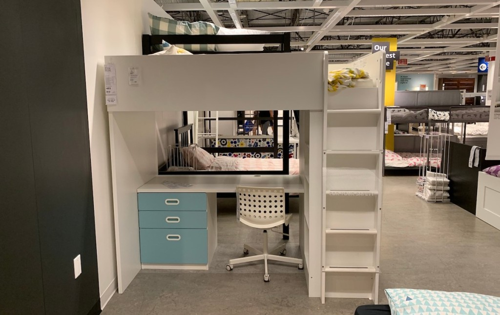 loft bed with blue drawers and ladder