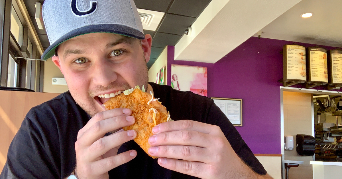 man eating Taco Bell cheddar chalupa