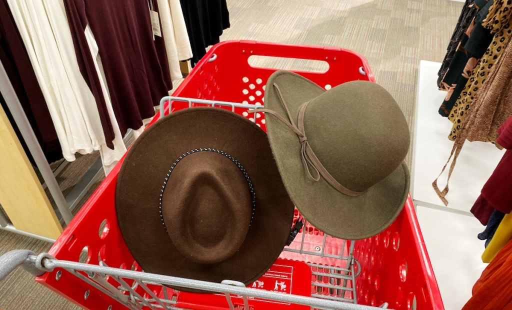 brown and green felt hats in red target cart