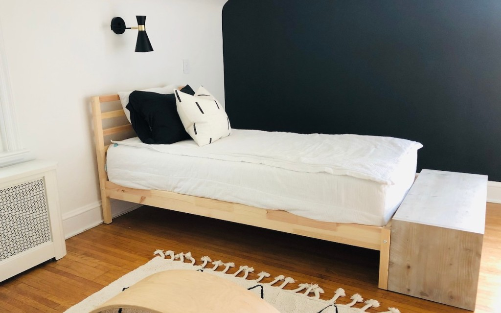 kids IKEA TARVA bed with white bedding