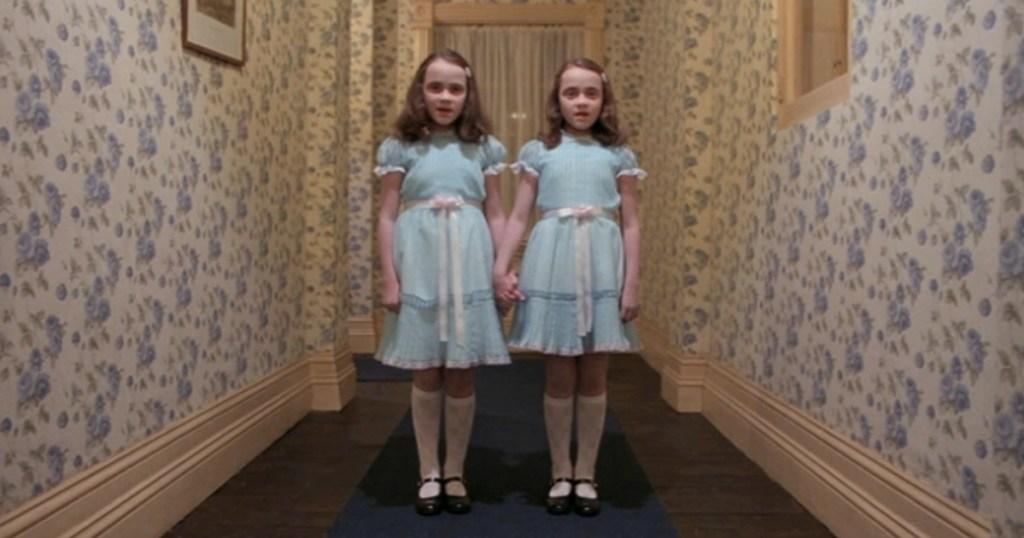 The Shining twins in a dark hallway