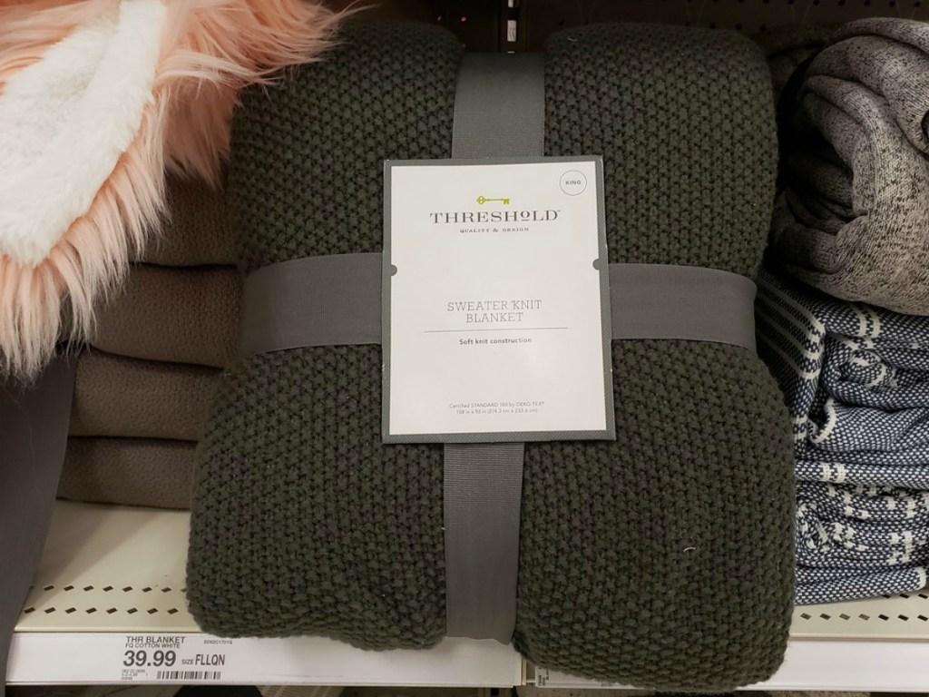 dark green blanket on store shelf