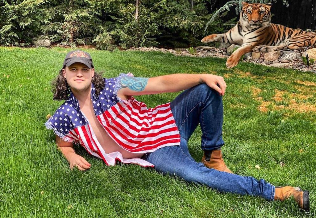 man wearing american flag shirt dressed as tiger king