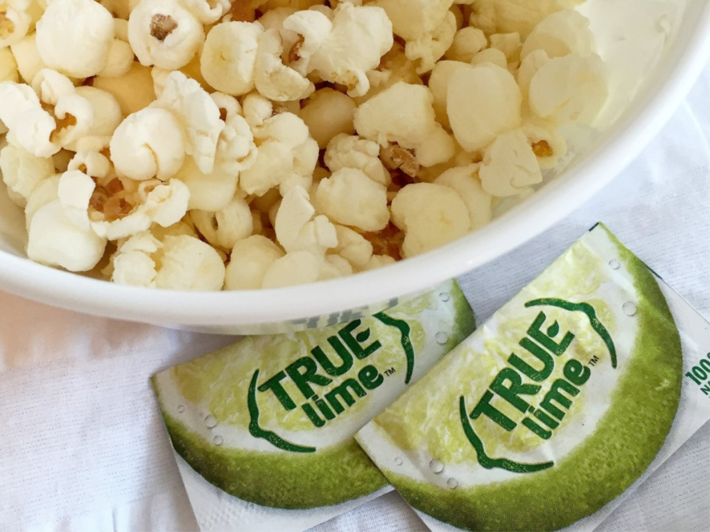 true lime packets sitting next to popcorn bowl