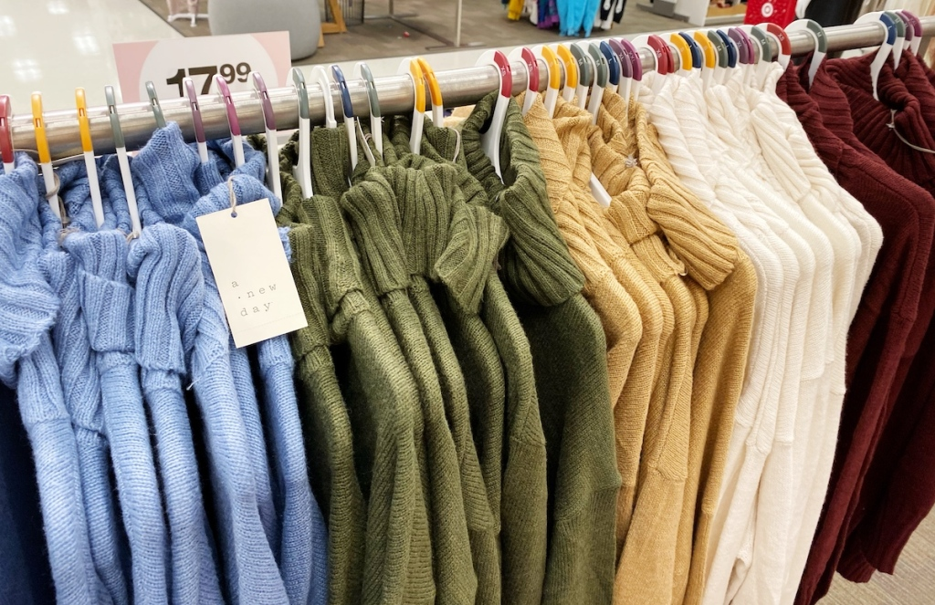 blue green golden yellow white and burgundy turtleneck sweaters on hangers