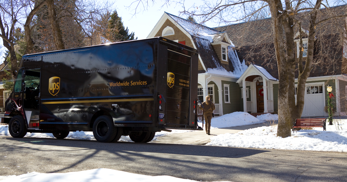 UPS truck delivering in snow