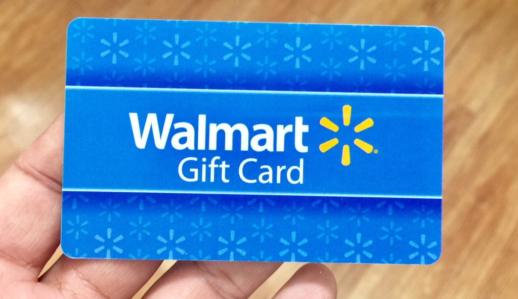 Person holding Walmart gift card