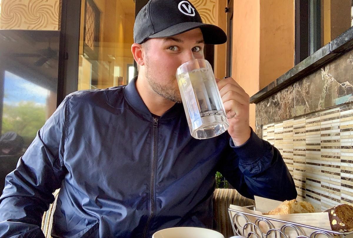 stetson drinking glass mug of water