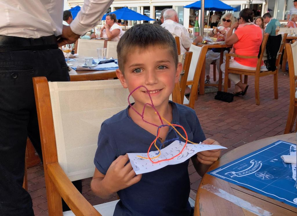 boy holding paper with wikkistix string