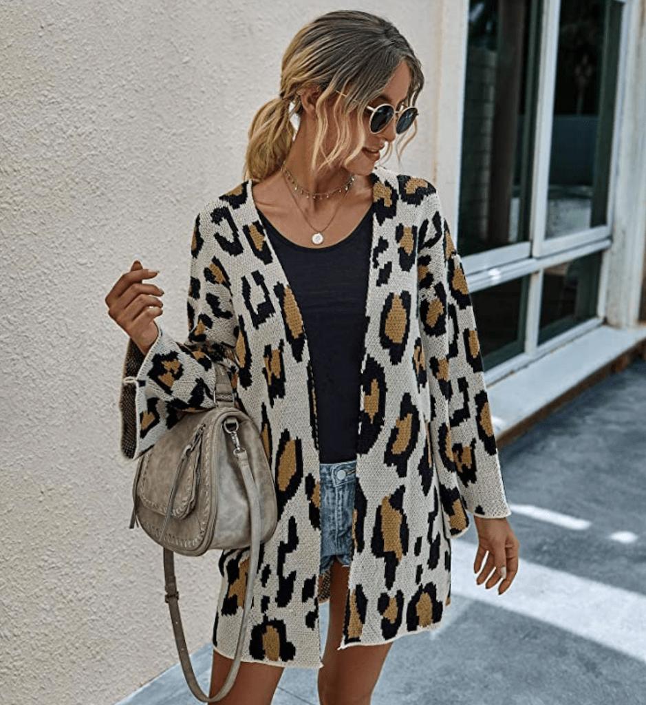 woman wearing leopard print cardigan outside