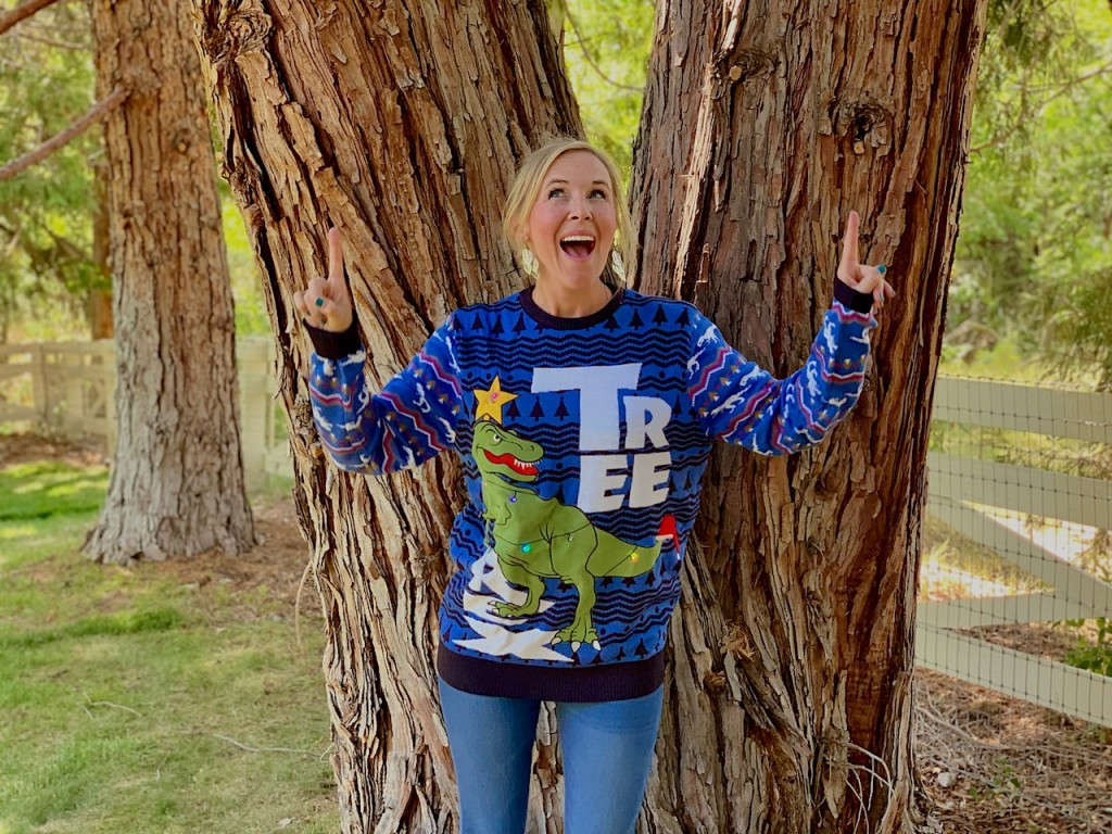 woman wearing tree rex ugly Christmas sweater
