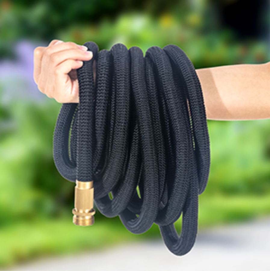 woman with hose wrapped around arm with blurry background