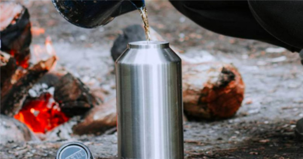 coffee pouring into yeti rambler at campsite
