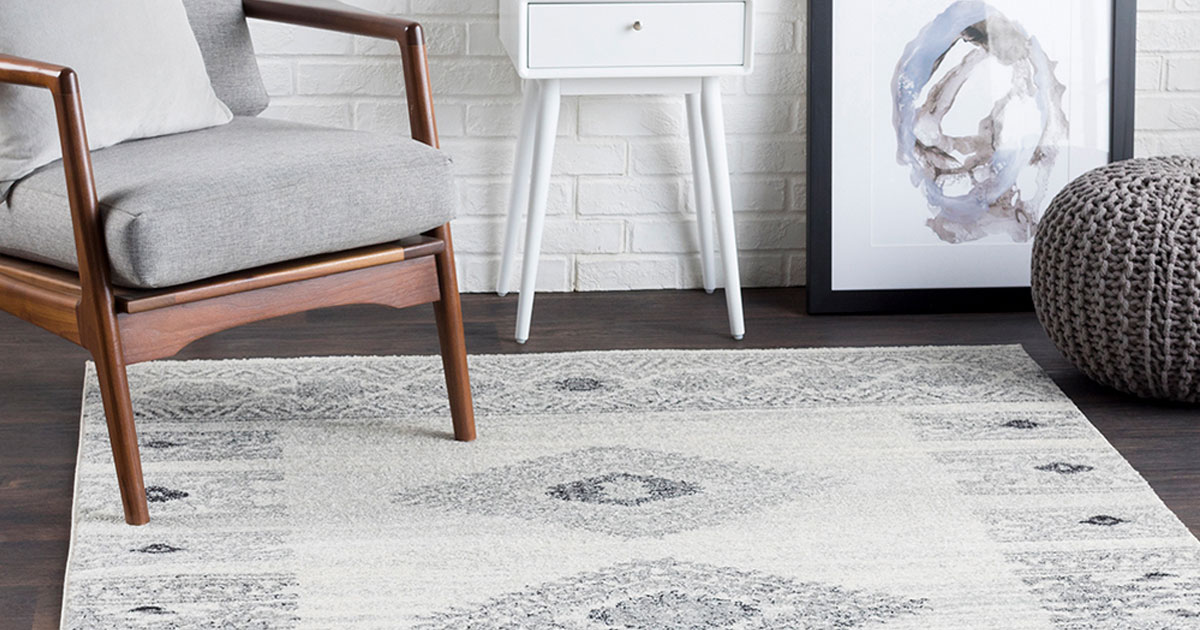 Zulily area rugs 5' x 7' in room with chair and ball ottoman