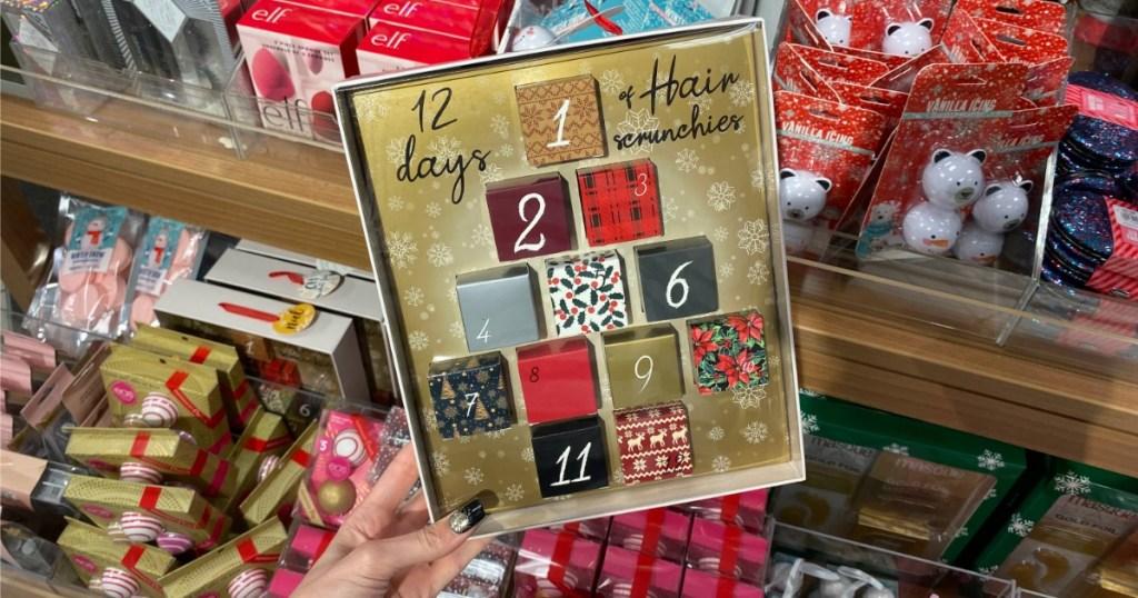 Woman holding 12 Days of Hair Scrunchies Advent Calendar Set